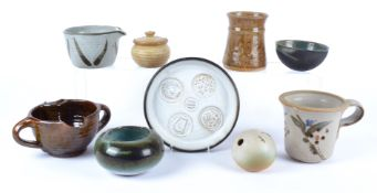 Ten pieces of 20th Century British studio pottery to include a half spherical bowl with a