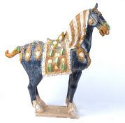 A large 20th Century Chinese sancai glazed statue of a horse after the Tang, a/f with loss to ear,