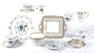 A Wedgwood part tea set with a design of leaves and berries, picked out in copper red, green and