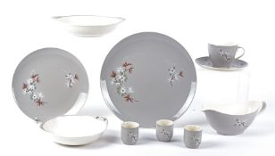 An extensive Royal Doulton 'Frost Pine dinner service' with stylised Winter plant life design, to