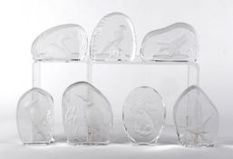 A late 20th Century glass paperweight collection, each object individually boxed and predominantly