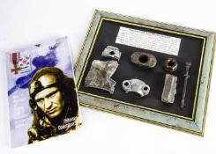 A framed display of fragments of Polish Fighter Pilot Waclaw Lapkowski's Hurricane, shot down over