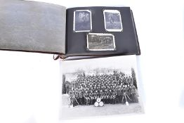 A WWII period German black and white photograph album, containing numerous black and white images of