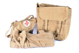 A complete WWII British First Aid kit, the canvas bag dated 1942, complete with unopened contents,