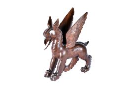 A carved wooden model of a Griffin, 41cm H