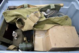Three British WWII period gas masked, together with a selection of items, comprising entrenching