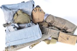 A selection of US military items, to include a 1942 bottle and cover, 1946 satchel, wedding and