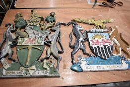 A cast iron Coat of Arms of Rhodesia, together with a cast iron Coat of Arms of the Federation of