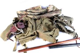 A small selection of military webbing, together with a water bottle and case, two marching stick,
