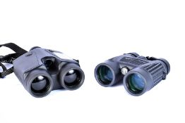 A pair of Bushnell range finders, together with a pair of Bushnell FOV368FT waterproof binoculars,
