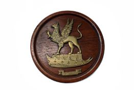 A brass and wooden wall plaque for H.M.S Revenge, this was acquired by a friend of the vendor who