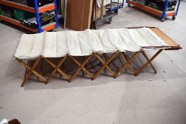 A mid 20th Century 'All British' fold out camp bed, having concertina wooden frame with canvas