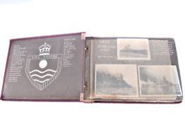 A photograph album for H.M.S Phoebe, containing various black and white photographs, with hand