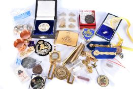 An assortment of various items, to include a Rhodesian belt buckle, cap badges, metal and cloth,