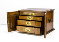 A Victorian walnut cutlery box, with a pair of hinged front doors opening to reveal four graduated