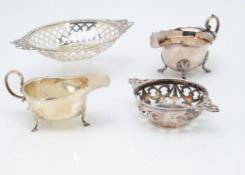 A late Victorian silver oval pierced bon bon dish, together with a George V silver sauce boat and