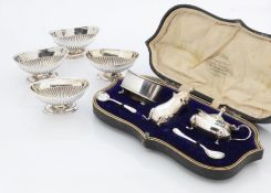 A set of four Victorian elliptical footed table salts by Charles Boynton, together with a cased part