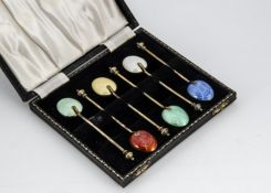 A cased set of six 1950s silver gilt and enamelled coffee spoons from Adie Bros