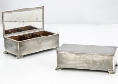 A pair of 1940s silver cigarette boxes from Mappin & Webb, each 18.5cm and approximately 20 ozt,