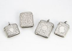 Four Victorian and later silver vesta cases, each engraved, three with fob loops, 5.5cm to 4.3cm (4)