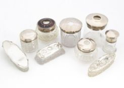 A group of nine Victorian and later glass and silver mounted dressing table items, including a