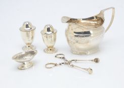 A George III silver helmet shaped milk jug, together with a pair of Victorian silver peppers by