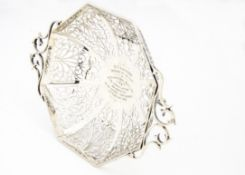 An Edward VII silver centre piece bowl, the pierced octagonal footed bowl with twin handles and