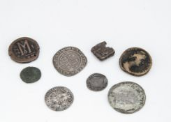 A collection of ancient and antique coins, including several Roman examples, a rectangular Celtic