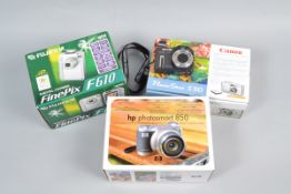Digital Compact Cameras, a Canon PowerShot S50, HP Photosmart 850, Fujifilm F610, all in makers