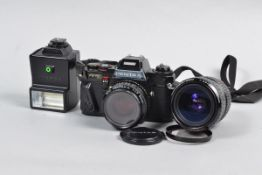 A Pentax Program A SLR Camera, serial no 1318624, black, body F, whitening to front of pentaprism