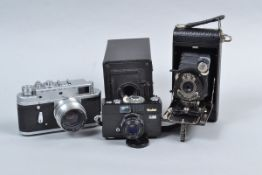 A Rollei B35 and Other Film Cameras, comprising a black Rollei B35, made in Singapore, serial no