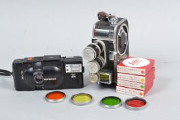 Olympus XA 35mm Camera and a Bolex B8L 8mm Camera, an XA compact 35mm camera with A11 electronic