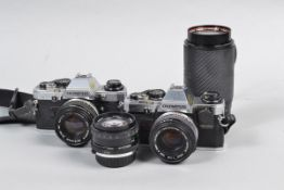 Two Olympus OM10 SLR Cameras, serial no 2743960 body G, shutter working with Manual Adapter,