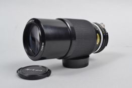 A Nikon Zoom-Nikkor 80-200mm f/4.5 AI Lens, serial no. 905145, barrel G-VG, elements G, dust, with