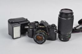 """A Canon A-1 SLR Camera Outfit, serial no 812730, body F-G, shutter working with """"squeak"""", meter"""