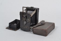 A German Miniature Strut Folding Plate Camera, serial no 5585, circa 1910, similar to Ensignette,