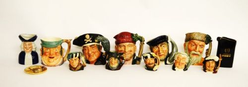 A collection of Royal Doulton character jugs, including Robinson Crusoe D6532, Lumberjack D6610,