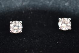 A pair of brilliant cut diamond ear studs, four claw setting on white metal post backs, 0.40ct, 1.