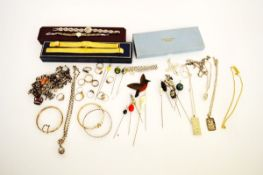 A collection of silver jewellery, including a curb link charm bracelet, a belcher link pomander