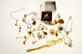 A collection of silver and costume jewels, including an oval agate pendant, two mauve set