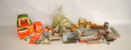 A quantity of Hornby Model Railway Layout buildings and accessories, including a boxed tunnel, etc