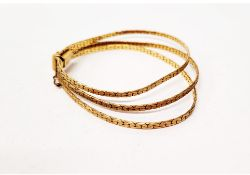 A three stand flattened curb link 9ct gold bracelet, with tongue and box clasp with safety clasp,