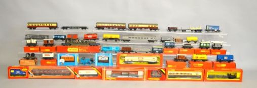 A quantity of boxed and unboxed Hornby OO Gauge rolling stock, including coaches, wagons, etc.