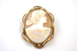 A 19th Century shell cameo, and pinchbeck brooch with the profile of a classical female, 5.5cm x