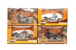 Four 1:10 American Muscle Ertl Collectibles Harley-Davidson motorcycle models, all boxed.