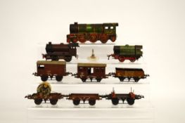 A quantity of Hornby O Gauge tin plate railway, including a clockwork tank 0405600 and rolling stock