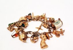 A 9ct gold curb link padlock clasp charm bracelet, with charms including cuckoo clock, kettle,
