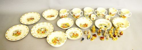 A collection of nursery ware, including various Bunnykins plates by Royal Doulton, chocolate cups