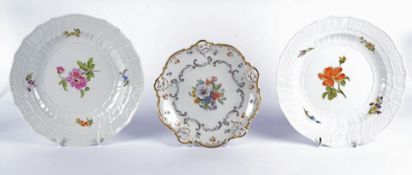 A pair of German Meissen porcelain plates with central floral sprays, moulded rims and cavettos,