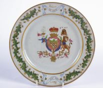 A late 19th Century Samson French armorial style porcelain plate with a design based upon the